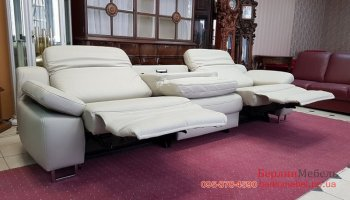Фирменный кожаный диван реклайнер HUKLA